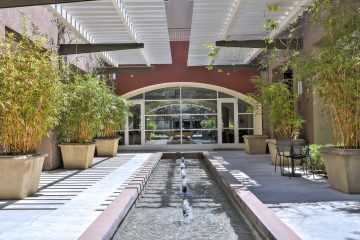 Fruitdale Station Apartments Clubroom Front Entrance Water Feature & Landscaping