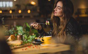 Woman Eating at Restaurant