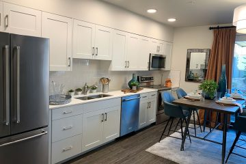 view of kitchen appliances and table of nexus on 9th apartment interior