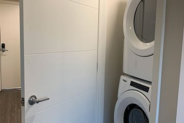 washer and dryer unit in nexus on 9th apartment interior